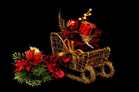 Christmas gift on sleigh on black background  写真素材