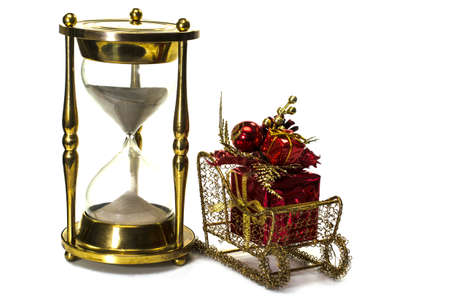 Christmas gift on sleigh and hourglass on white background   Concept showing time running out for Christmas shopping