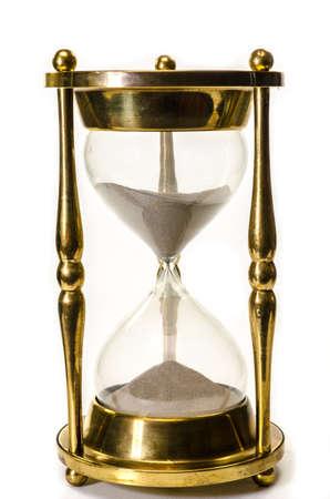 reloj de arena: Reloj de arena de oro aisladas sobre fondo blanco Foto de archivo