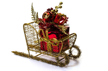 Christmas gift on sleigh isolated on white background.