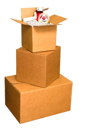 Shipping boxes with packing peanuts and tape dispenser isolated on white background with clipping path.