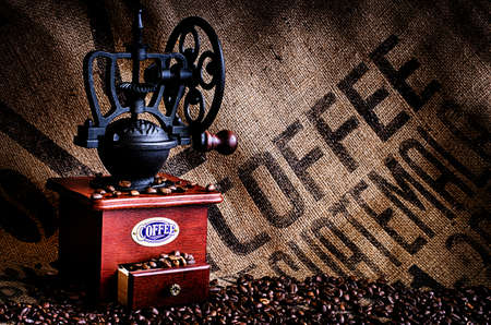 jamoke: This image is of coffee beans, coffee grinder, and coffee beans bag in background.