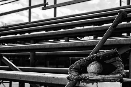 Baseball practice monochrome with ball in glove and bat on bleachers Stock Photo - 25971147