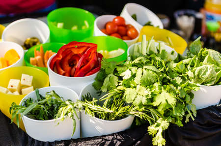 Salad ingredients with lettuce, tomatoes, cucumbers, and cheese