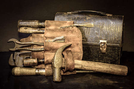 working belt: Lunch break with old vintage tool belt and tools with lunch box. Stock Photo