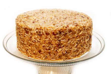 Whole german chocolate cake on plate isolated on white background.
