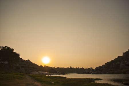 sunset in the river in Hampi