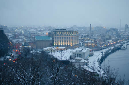 Winter landscape in the town Kiev. Snow covered city at dusk.