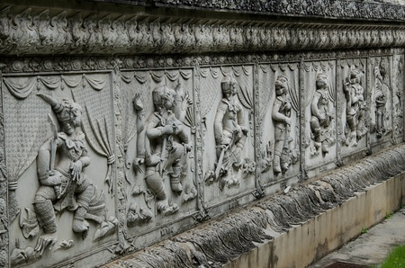 Ramayana Bas Relief on Wall of Fence at Wat Panan Choeng Temple in Ayutthaya Thailand  photo