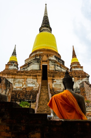 Buddha Statue and Ancient Stupa  in Ayutthaya, Thailand  photo