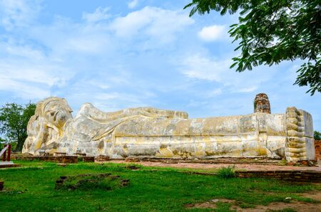 The World Heritage - Ancient Reclining Buddha Statue in Ayutthaya, Thailand  photo