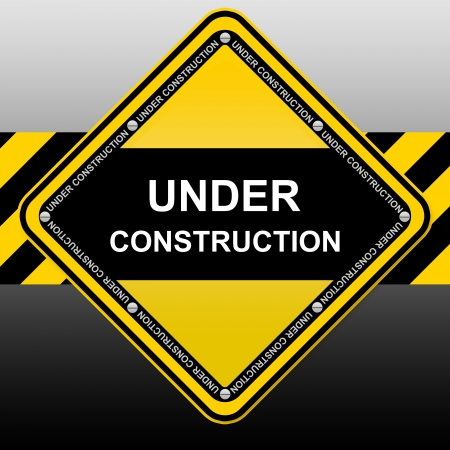 Yellow and Black Under Construction Sign  photo