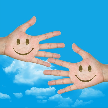 Smile Face in Hand With Blue Sky Background photo