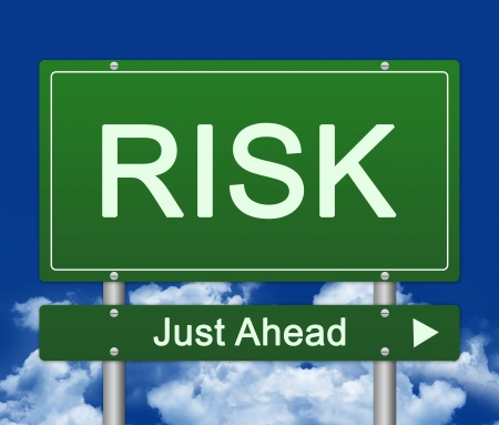 just ahead: Risk Just Ahead Traffic Sign Against A Blue Sky Background