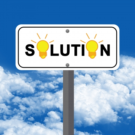 Solution Road Sign With Light Bulb Against A Blue Sky Background photo