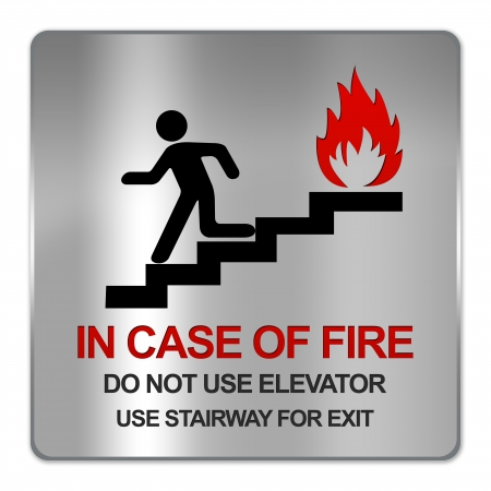no fires: Square Silver Metallic Plate For In Case Of Fire Do Not Use Elevator Use Stairway For Exit Sign Isolate on White Background Stock Photo