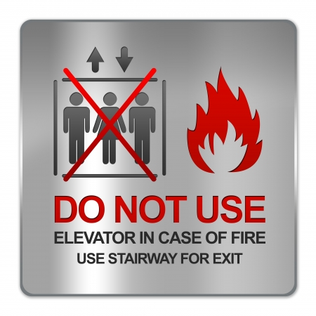Square Silver Metallic Plate For Do Not Use Elevator In Case Of Fire Use Stairway For Exit Sign Isolate on White Background  photo