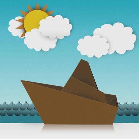 Beautiful Origami Made From Recycle Paper, Boat Sailing in The Sea With Sunny and Blue Sky Background photo