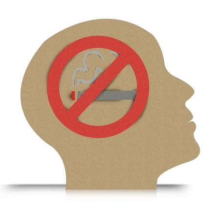 No Smoking Concept, Present By No Smoking Sign in Brain Made From Recycle Paper Isolate on White Background  photo