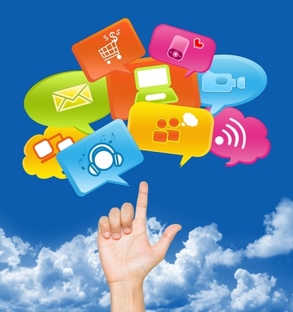 Hand With internet Communication Icon Above in Blue Sky Background For Social Media, Social Marketing or E-Commerce Concept Stock Photo - 17607623