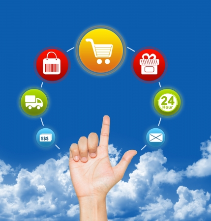 Hand With E-Commerce Icon Around For Internet and Online Shopping Concept in Blue Sky Background  photo