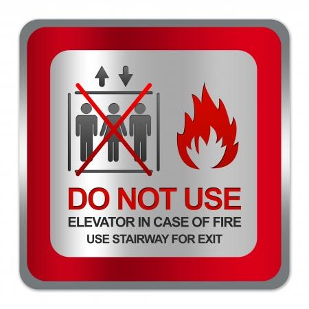 no correr: Plaza Silver Metallic con placa Frontera roja para No usar ascensor en caso de incendio Escalera uso para la muestra de la salida aislada en el fondo blanco Foto de archivo
