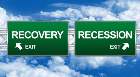 Two Choices Of Green Highway Street Sign Between Recovery And Recession Sign For Business Direction Concept Against A Blue Sky Background photo