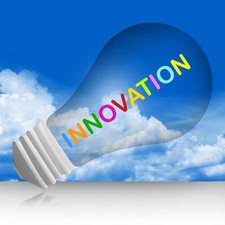 Colorful Innovation Text Inside The Light Bulb For Business Concept in Blue Sky Background  photo