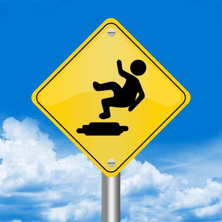 Yellow Rhombus Road Sign For Slippery Floor Against The Blue Sky Background  photo