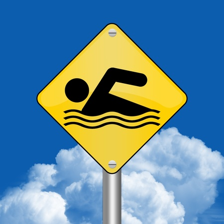 Yellow Rhombus Road Sign For Swimming Zone Against The Blue Sky Background  photo