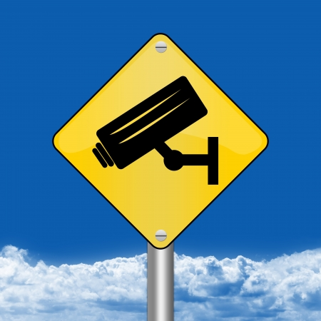 loitering: Yellow Rhombus Road Sign For No Trespassing With CCTV Sign Against The Blue Sky Background