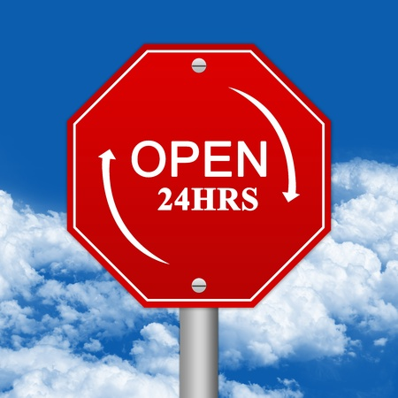 Hexagon Red Traffic Sign For Open 24 HRS Against The Blue Sky Background  photo