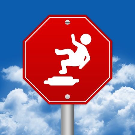 Hexagon Red Traffic Sign For Slippery Floor Against The Blue Sky Background  photo