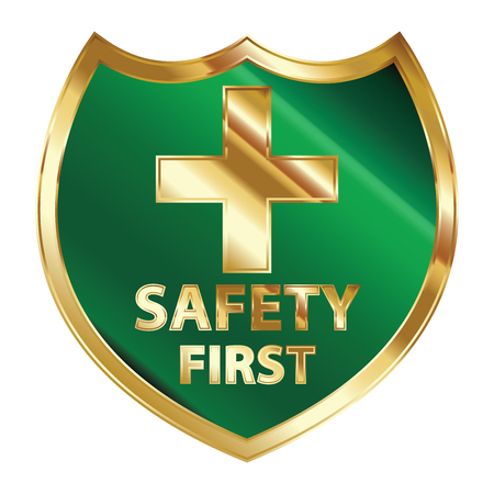 Safety First Concept, Green and Golden Metallic Style Shield With Golden Cross Sign and Safety First Text Isolated on White Background photo