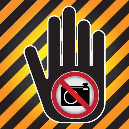 no cameras allowed: No Photo or No Camera Prohibited Sign Present By Hand With No Camera Sign Inside in Caution Zone Dark and Yellow Background