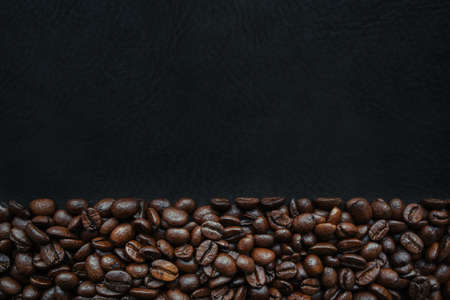 non alcoholic beverage: Juicy coffee beans on the texture. Brown