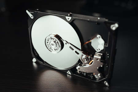 Opened hard drive from the computer (hdd) with mirror effects. Part of computer (pc, laptop)