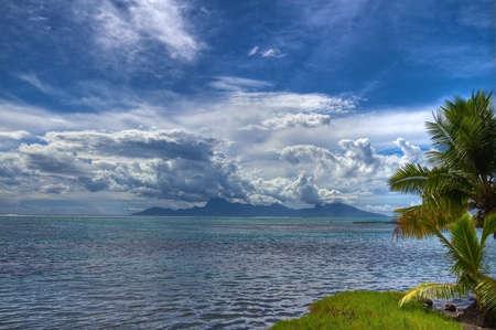 motu: Moorea in rainy season from Tahiti. Stock Photo