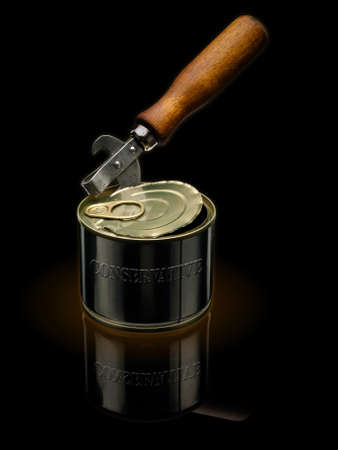 key punching: Ancient can opener and modern tin. Stock Photo