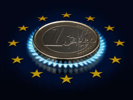 Coin one EURO, a gas flame and an European Union flag. photo