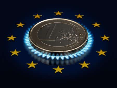 Coin one EURO, a gas flame and an European Union flag. photo