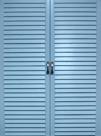 jalousie: The closed doors of a jalousie of blue colour