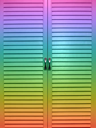 The closed doors of a jalousie of multi-coloured colour  photo