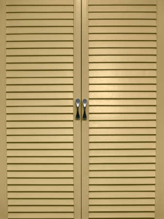 jalousie: The closed doors of a jalousie of yellow colour