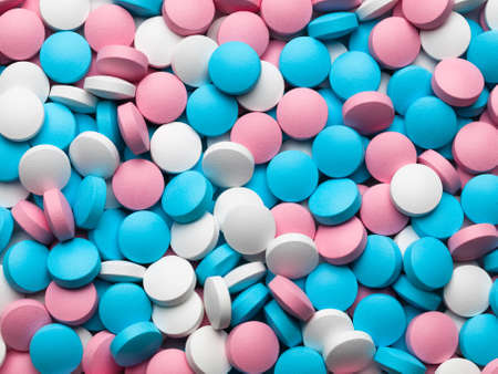 A considerable quantity of multi-coloured pills  photo