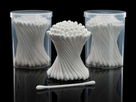 focus stacking: Bunch and separate cotton buds with two plastic packing on a black background