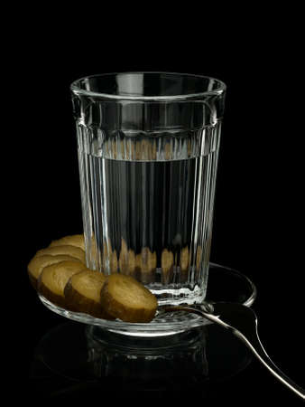 focus stacking: Thick glass tumbler, pickle and steel fork in a plate