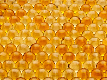 Background from pills and cod-liver oil capsules  photo