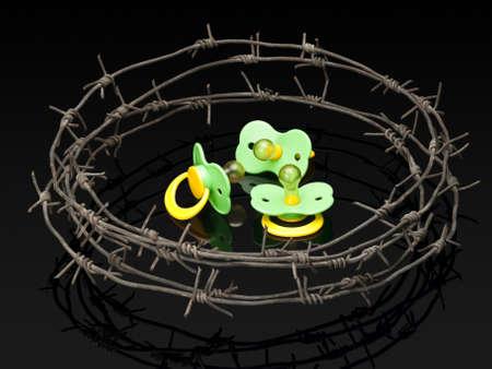 baby's dummies: Three babys dummies behind a barbed wire