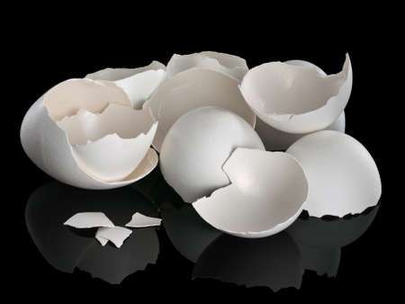 broken egg: Heap of a white, egg shell on a black background Stock Photo